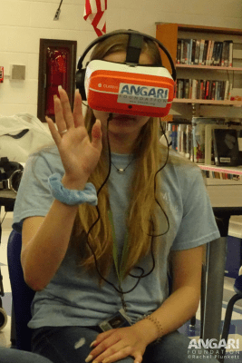 A student views the 360 film Generation Ocean: Coral Reefs with a ClassVR headset